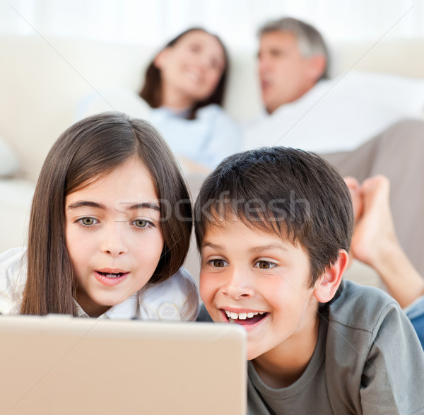 Lovely children watching a movie on their laptop at home Stock photo © wavebreak_media