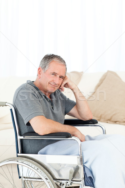 Stock photo: Retired man in his wheelchair at home