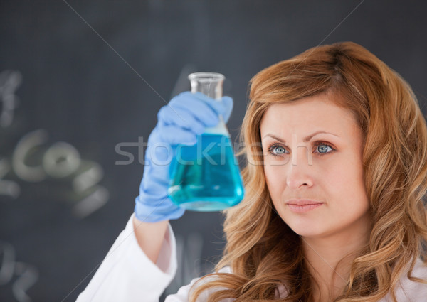Cute female scientist carrying out an experiment in a laboratory Stock photo © wavebreak_media