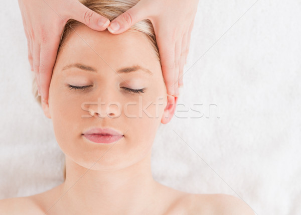Delighted young woman getting a massage on her face in a Spa centre Stock photo © wavebreak_media