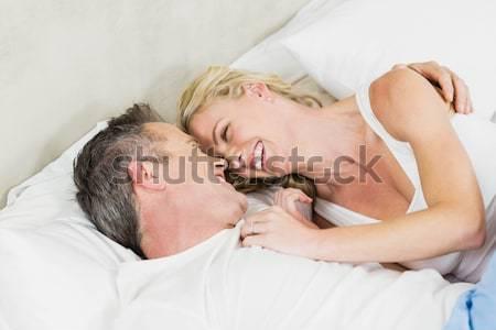 Portré pár tudomás mosoly ágy szex Stock fotó © wavebreak_media