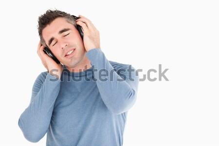 Porträt Mann genießen Musik weiß Gesicht Stock foto © wavebreak_media