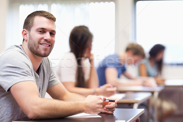 Smiling young man sitting in a classroom Stock photo © wavebreak_media