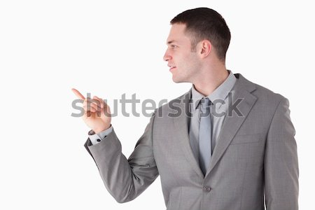Businessman pointing at something against a white background Stock photo © wavebreak_media
