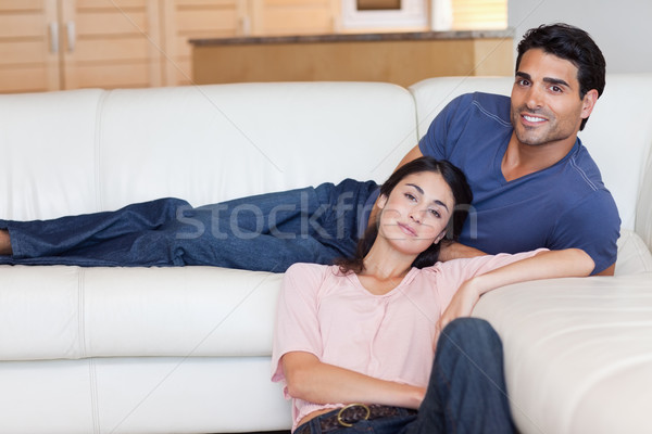 Charming couple posing in their living room Stock photo © wavebreak_media