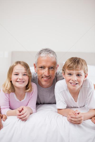 Portre kardeşler baba poz yatak odası aile Stok fotoğraf © wavebreak_media