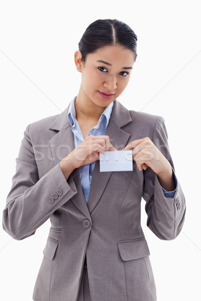 Portrait of a young businesswoman clipping her badge against a white background Stock photo © wavebreak_media