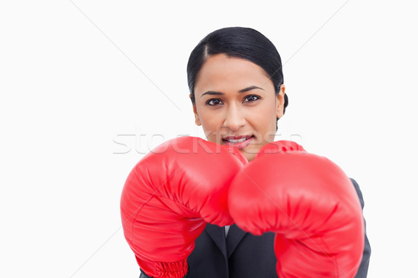 Close up of confident saleswoman with boxing gloves against a white background Stock photo © wavebreak_media