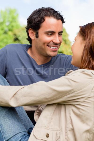 Dois amigos alegremente olhando olhos sentar-se Foto stock © wavebreak_media