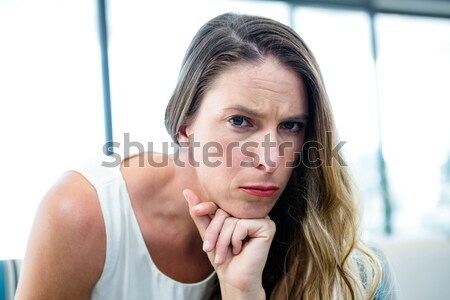 Frowning student head on her books against white background Stock photo © wavebreak_media