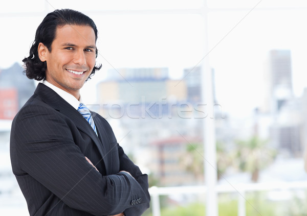 Young executive standing upright in front of a window and proudly looking towards the side Stock photo © wavebreak_media