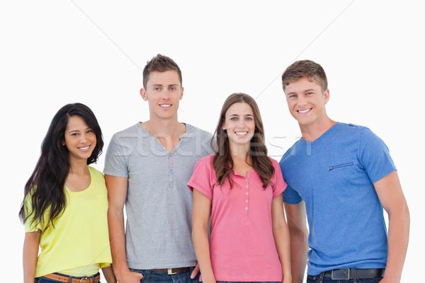 Cztery osoby stałego obok inny uśmiechnięty Zdjęcia stock © wavebreak_media