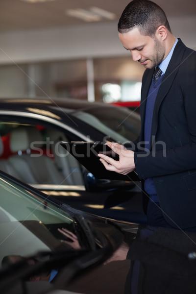 продавцом Дать буфер обмена гаража костюм черный Сток-фото © wavebreak_media