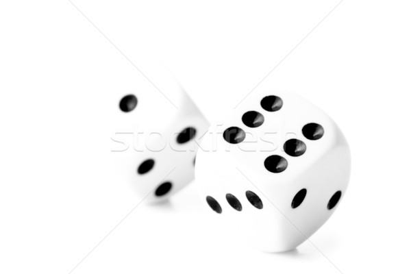 Two black and white dices against a white background Stock photo © wavebreak_media