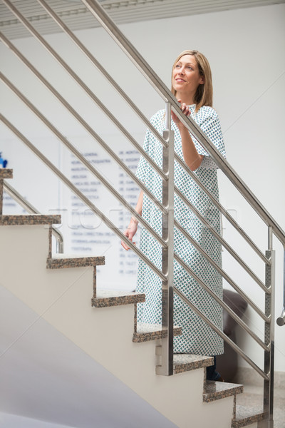 Female patient walking up stairs in hospital corridor Stock photo © wavebreak_media