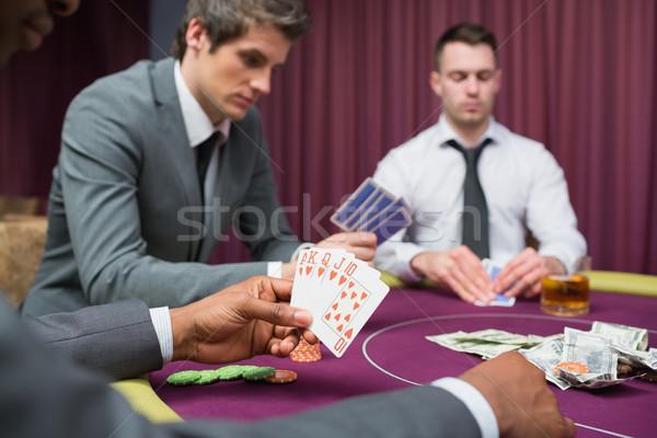 Erkekler oynama poker kumarhane el tablo Stok fotoğraf © wavebreak_media