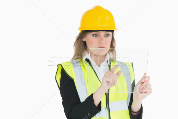 Female architect touching on a pane while holding it Stock photo © wavebreak_media