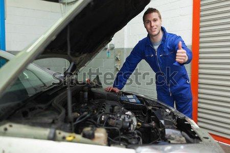 Repairman standing by car with open hood Stock photo © wavebreak_media