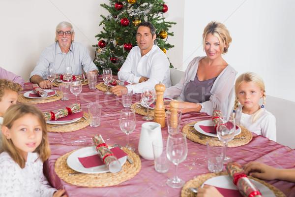 Smiling family at the dinner table Stock photo © wavebreak_media