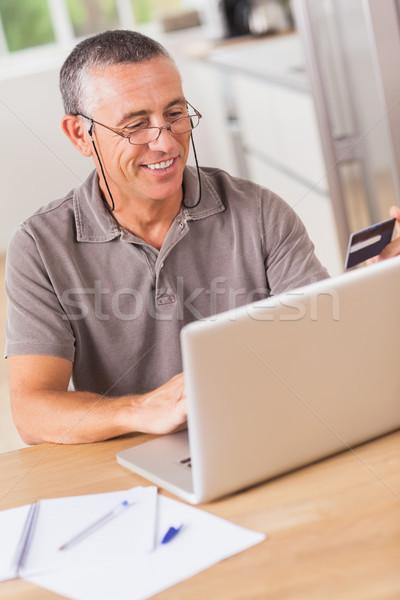 Man online shopping with laptop Stock photo © wavebreak_media