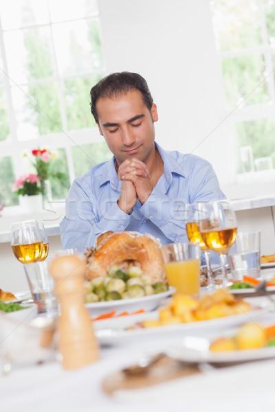 Man saying grace before dinner Stock photo © wavebreak_media