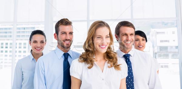 Feliz equipo de negocios junto oficina pie brillante Foto stock © wavebreak_media