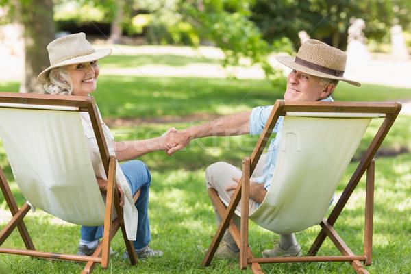 Entspannt reifen Paar Sitzung Deck Stühle Stock foto © wavebreak_media