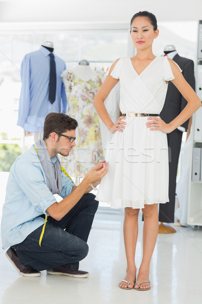 Fashion designer adjusting dress on model Stock photo © wavebreak_media