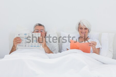 Therapist taking notes on her patient on the sofa Stock photo © wavebreak_media