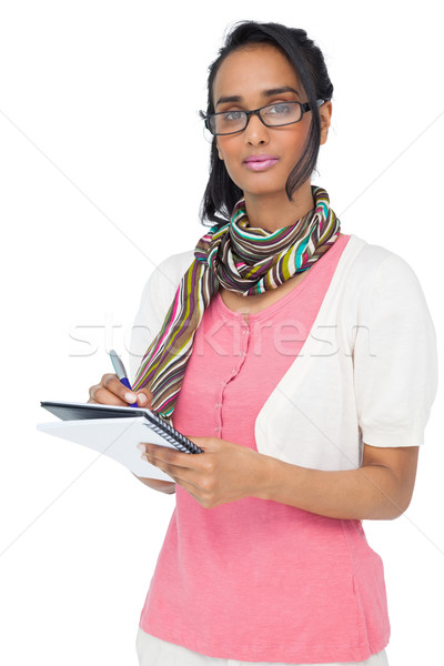 Portrait of a cool young woman writing in notepad Stock photo © wavebreak_media