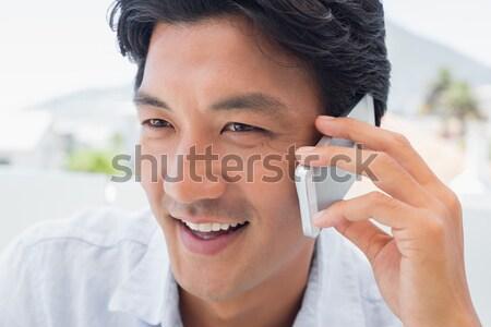 Sério homem telefonema fora varanda casa Foto stock © wavebreak_media