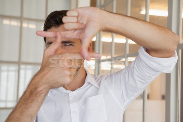 Casual businessman framing with his hands Stock photo © wavebreak_media