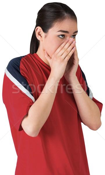 Nervous football fan looking ahead Stock photo © wavebreak_media