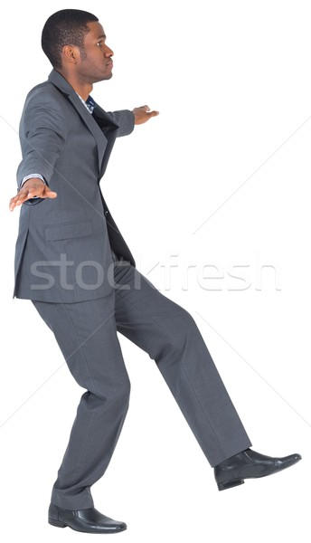 Businessman performing a balancing act Stock photo © wavebreak_media
