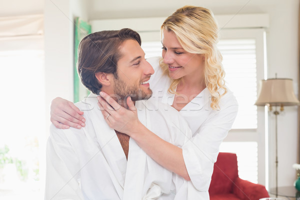 Cute couple in bathrobes spending time together Stock photo © wavebreak_media