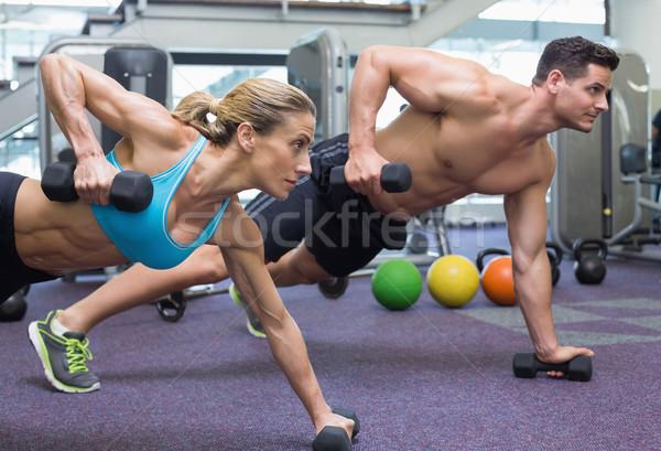 Bodybuilding uomo donna manubri Foto d'archivio © wavebreak_media