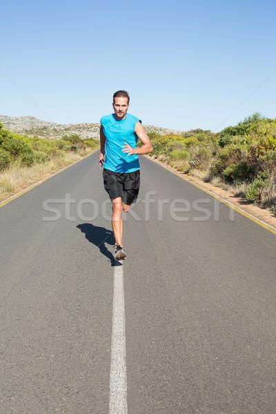 Fit man jogging on the open road Stock photo © wavebreak_media