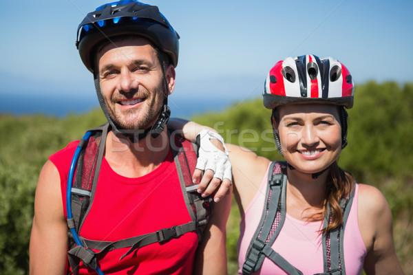 アクティブ カップル サイクリング 笑みを浮かべて カメラ ストックフォト © wavebreak_media
