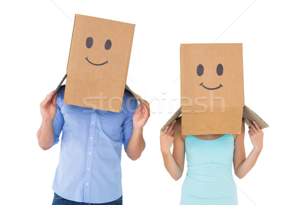 Couple wearing emoticon face boxes on their heads Stock photo © wavebreak_media
