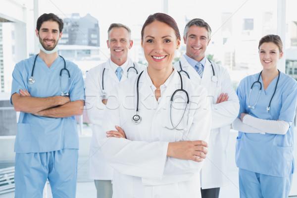 Smiling doctor with fellow doctors Stock photo © wavebreak_media