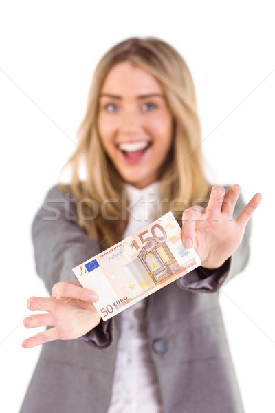 Stylish blonde showing fifty euro note Stock photo © wavebreak_media