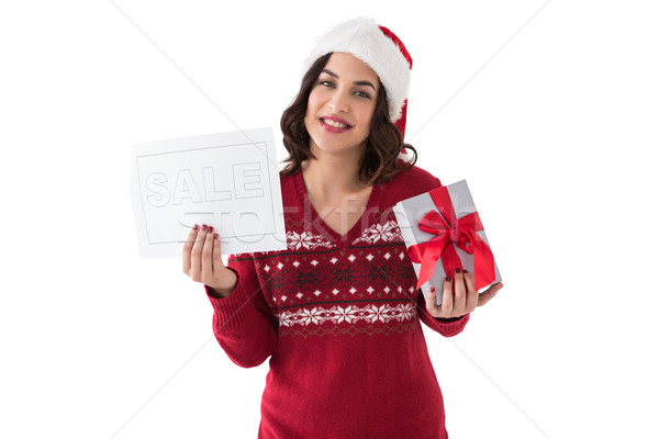 Brunette holding gift and sale sign  Stock photo © wavebreak_media