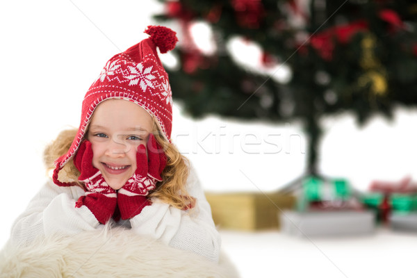 Festive little girl in hat and scarf Stock photo © wavebreak_media