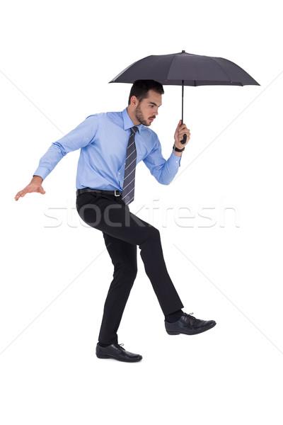 Fókuszált üzletember tart esernyő egyensúlyoz fehér Stock fotó © wavebreak_media