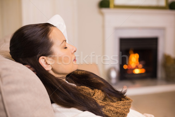 Pretty brunette relaxing on the couch at christmas Stock photo © wavebreak_media