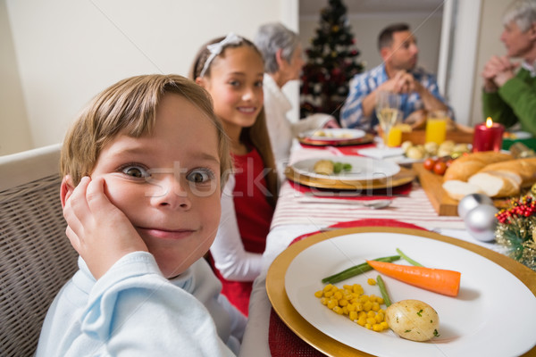 Stock photo: Portrait of little boy with a funny face at christmas dinner
