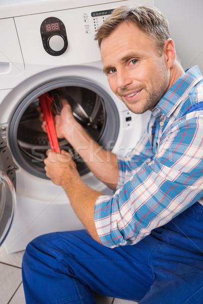 Klusjesman wasmachine keuken man werk Stockfoto © wavebreak_media