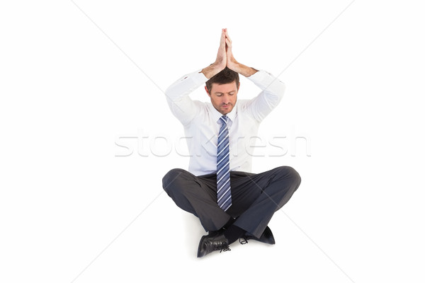 Businessman sitting in lotus pose with hands together Stock photo © wavebreak_media