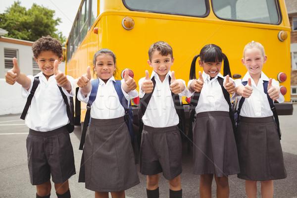 Cute школьников улыбаясь камеры школьный автобус за пределами Сток-фото © wavebreak_media