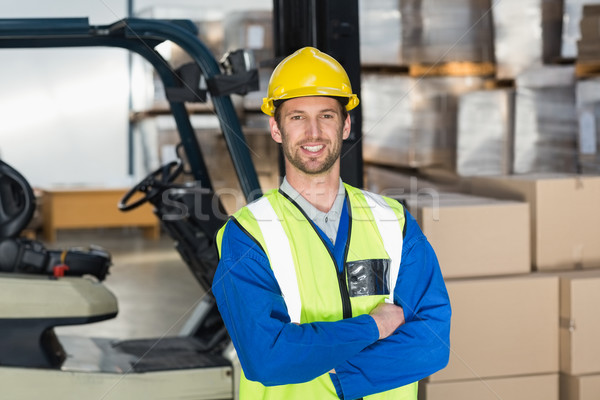 Worker wearing hard hat in warehouse Stock photo © wavebreak_media